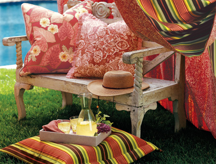 Vibrant colors add life to an antique wood bench.