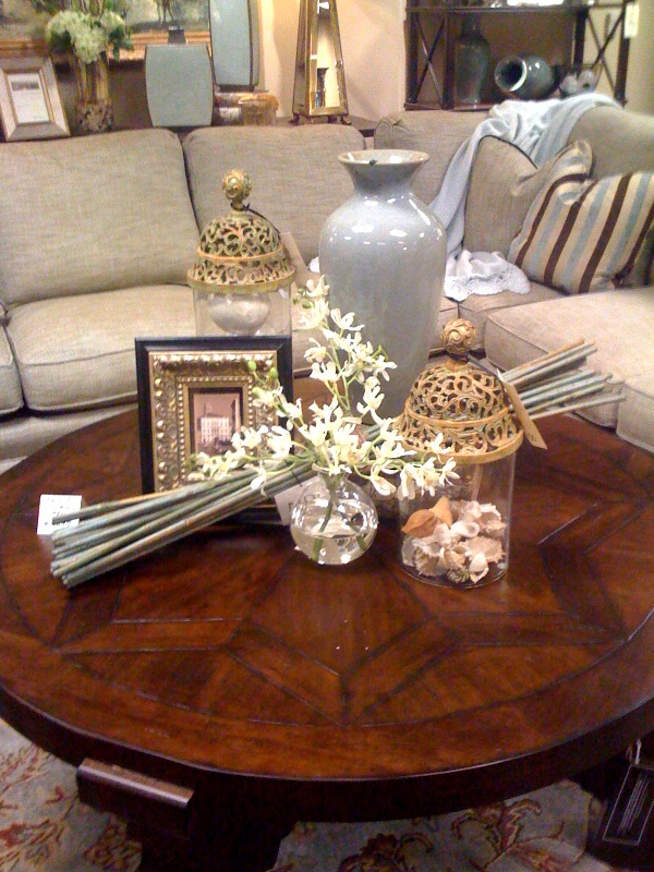 An electic mix of accessories give style to this dark wood round coffee table