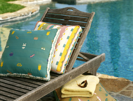 Swimsuit themed prints add a whimsical flair to this wooden chaise lounge.